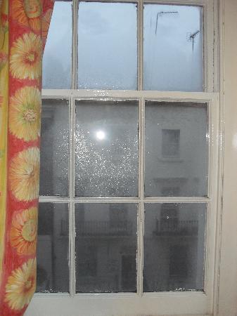 C mo limpiar vidrios o ventanales for Como limpiar cristales grandes